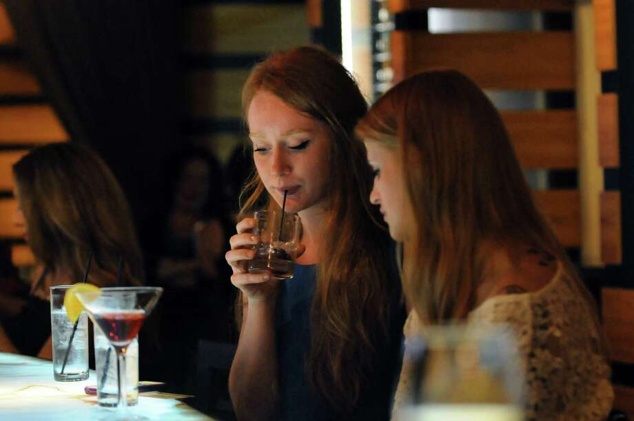 Sarah Fahey of Albany, center, has a drink with her roommate Amber DeGroff, right, on Thursday, May 23, 2013, at Creo in Guilderland, N.Y. (Cindy Schultz / Times Union) Photo: Cindy Schultz / 00022542A