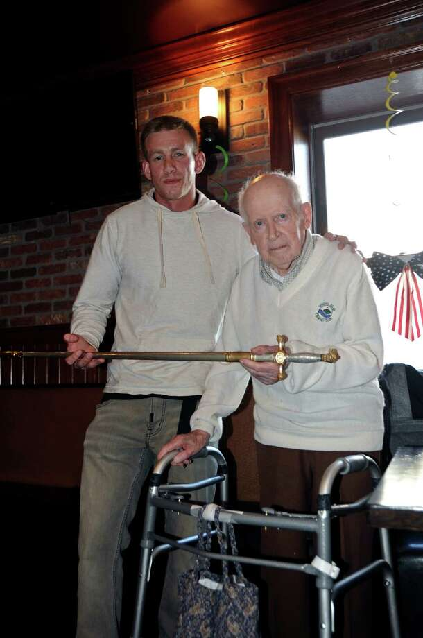 At a May 26 gathering of friends & family at the Lark Tavern to commemorate graduation from Northeastern University, as well as official Commissioning as a 2nd Lt. in the US Army, former City Treasurer Ray Joyce presented his grandson Jared Joyce with a special honorary keepsake: the sword he carried as a cadet and officer at Christian Brothers Academy over 70 years ago. (Daniel Joyce)