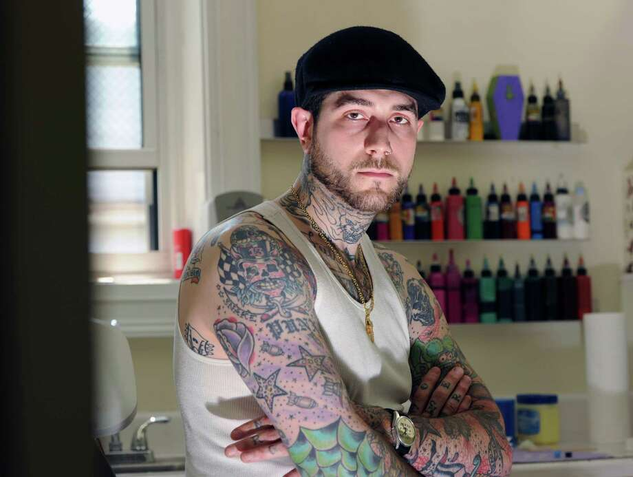 Joe Campagna, a co-owner of the tattoo studio, Byram Ink, at the studio in the Byram section of Greenwich, Tuesday, May 21, 2013. The state is in the process of passing legislation that would require Connecticut tattoo artists to take a training program, pass an exam and pay $250 license fees. Photo: Bob Luckey / Greenwich Time