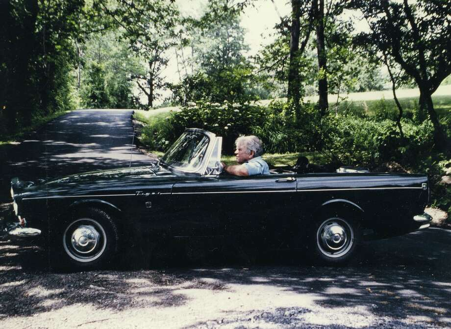 Andy Rooney sits in his 1966 Sunbeam Tiger as he watches a tennis match in Rensselaerville, N.Y., circa 1988. Photo credit Ellen Rooney. Photo: The (Stamford) Advocate