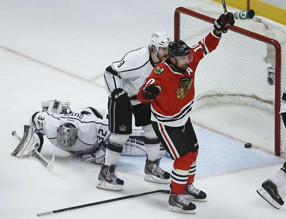 Blackhawks center Patrick Sharp (10) reacts after scoring against Kings goalie Jonathan Quick Photo: Charles Rex Arbogast, Associated Press