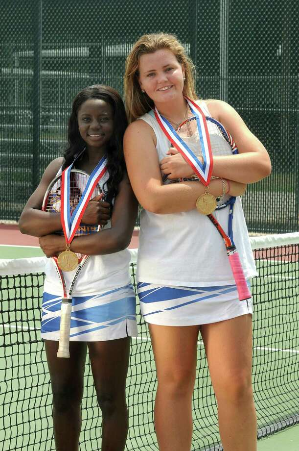 Klein seniors Princess Gbadamosi, left, and Emily Olivier knocked off the defending doubles champions to earn the Class 5A state championship. Photo: Jerry Baker, Freelance