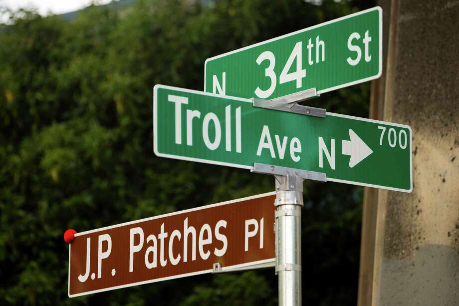 "The new J.P. Patches Place street sign is displayed Saturday, June 1, 2013, at the History House of Greater Seattle in Fremont. The newly named street section is located on North 34th Street between Fremont Avenue North and Troll Way North, and runs directly in front of the J.P. Patches and Gertrude ""Late for the Interurban"" statue in Fremont. Photo: JORDAN STEAD, SEATTLEPI.COM / SEATTLEPI.COM"