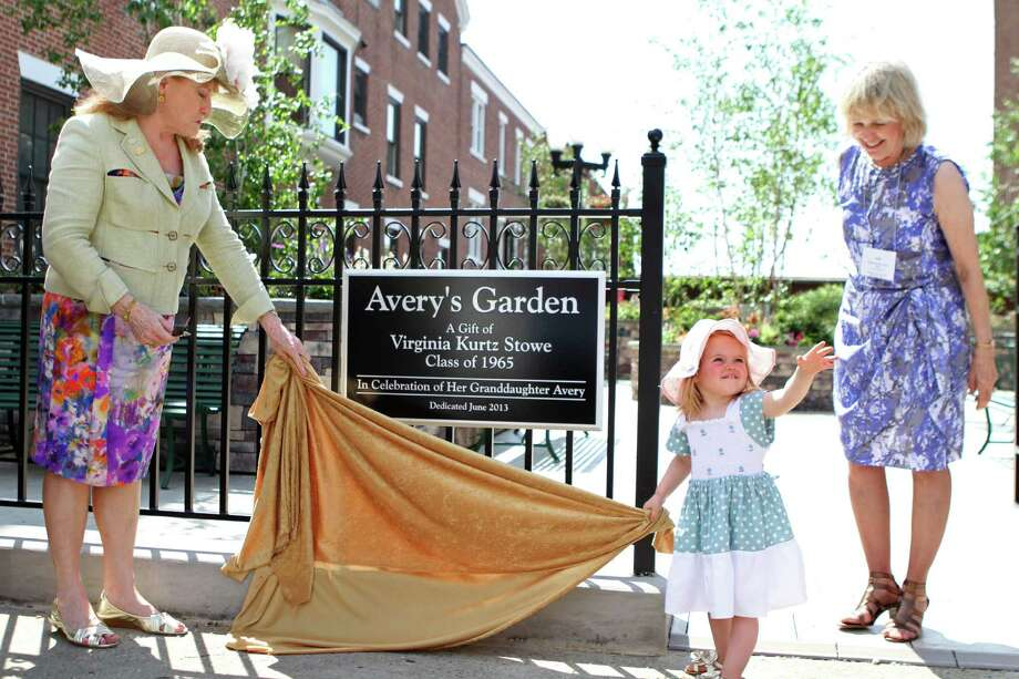 "At Russell Sage Reunion on Saturday in Troy, a group of alumna celebrate the dedication of newly-installed Avery's Garden, a gift from Virginia Kurtz Stowe '65 in tribute to her granddaughter. Virginia ""Ginny"" saw an area of campus that needed attention while attending her reunion in 2010, and reached out to the college to make this gift. The park, located above the Ferry Street Tunnel in what was previously concrete bunkers, was completed this spring. The garden was designed by New York City landscape architect Todd Haiman (himself a SUNY Albany alum) with an emphasis on native landscaping and sustainability, and provides a restful space for studying and gathering among the historic buildings of campus.Shown here are Sage President Susan C. Scrimshaw, Kurtz Stowe of New York City and granddaughter  Avery, age 2.  (Matt Milless)"