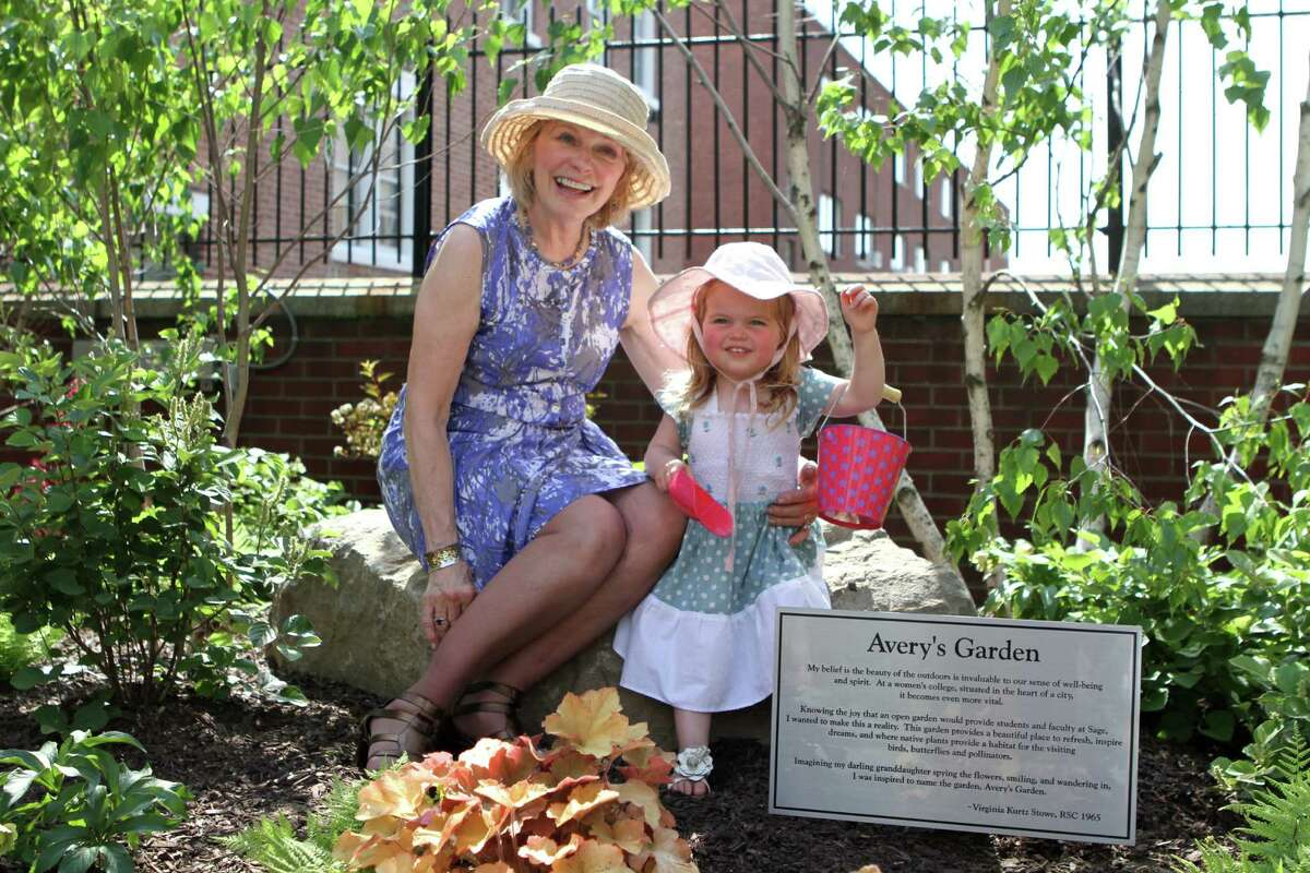 At Russell Sage Reunion on Saturday, a group of alumna celebrate the dedication of newly-installed Avery's Garden, a gift from Virginia Kurtz Stowe '65 in tribute to her granddaughter. Virginia