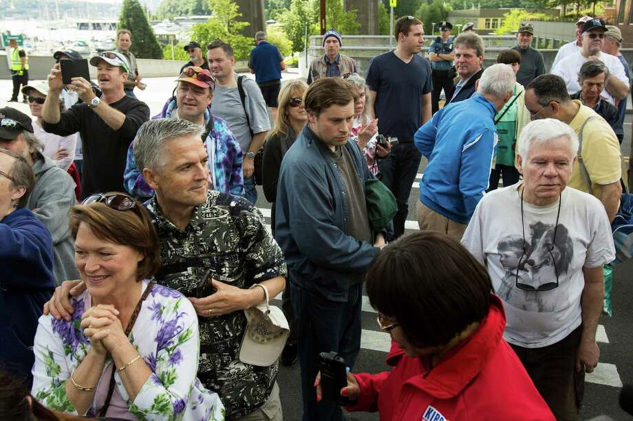 "Crowds gather to listen to the ceremony of a J.P. Patches Place street naming Saturday, June 1, 2013, at the History House of Greater Seattle in Fremont. The newly named street section is located on North 34th Street between Fremont Avenue North and Troll Way North, and runs directly in front of the J.P. Patches and Gertrude ""Late for the Interurban"" statue in Fremont. Photo: JORDAN STEAD, SEATTLEPI.COM / SEATTLEPI.COM"