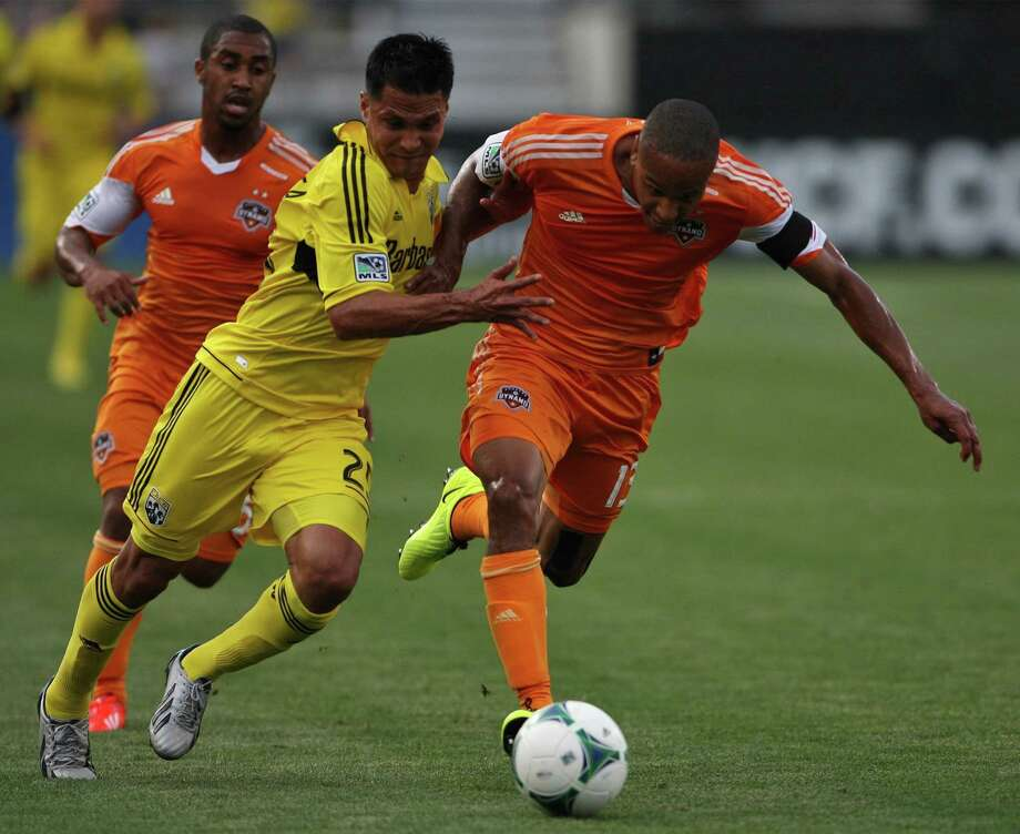 The Columbus Crew's Jairo Arrieta battles the Houston Dynamo's Ricardo Clark, right, for the ball at Columbus Crew Stadium on Saturday, June 1, 2013, in Columbus, Ohio. (Alex Holt/Columbus Dispatch/MCT) Photo: Alex Holt, McClatchy-Tribune News Service / Columbus Dispatch