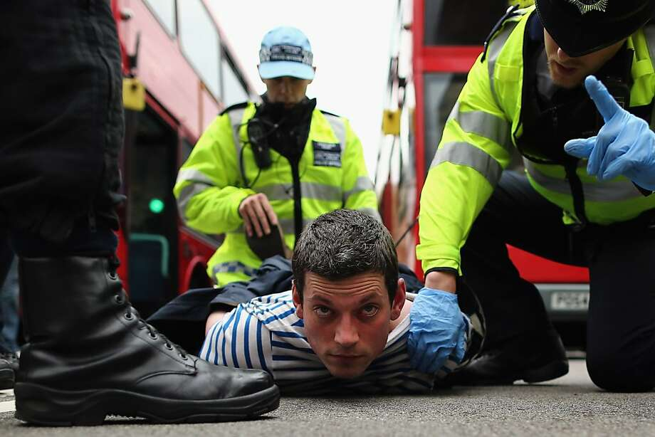 LONDON, ENGLAND - JUNE 01:  A protester is arrested after skirmishes with police on June 1, 2013 in London, England. Dozens of police officers attended a protest by the British National Party (BNP) and anti-fascist counter-protestors believed to be a part of (UAF) United against Fascism in Central London today. The BNP had planned to march from Woolwich Barracks but this was banned by Scotland Yard amid concerns over violent disorder. The protests follow the suspected terror attack in Woolwich on Wednesday 22, 2012 in which Drummer Lee Rigby of the 2nd Battalion the Royal Regiment of Fusiliers was brutally murdered. (Photo by Dan Kitwood/Getty Images)  Photo: Dan Kitwood, Getty Images