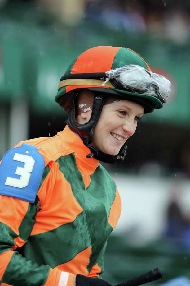 FILE - In this May 4, 2013 file photo, jockey Rosie Napravnik smiles on her mount before the Humana Distaff at Churchill Downs in Louisville, Ky. Napravnik is set to become the first female jockey to ride in all three Triple Crown races in the same year, and the first to try and win one aboard a filly. (AP Photo/Gregory Payan, File) Photo: Gregory Payan / AP