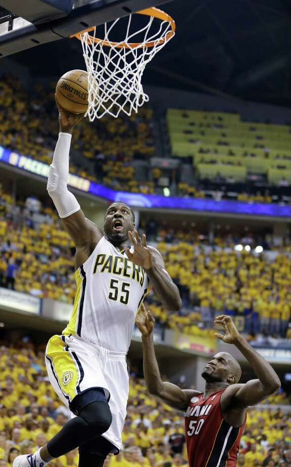Indiana Pacers center Roy Hibbert (55) goes up for a shot against Miami Heat center Joel Anthony (50) during the second half of Game 6 of the NBA Eastern Conference basketball finals in Indianapolis, Saturday, June 1, 2013. (AP Photo/Michael Conroy) Photo: Michael Conroy