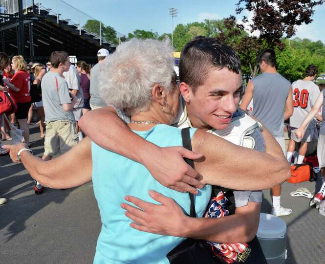 Niskayuna's #7 Matt DiVietro gets a hug from grandmother Maria Caruso after scoring six goals agains