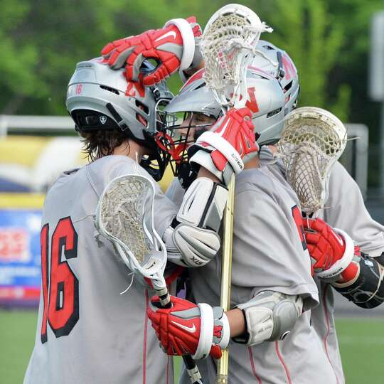 Niskayuna celebrate oneod their 22 goals against Cornwall during the lacrosse state tournament game