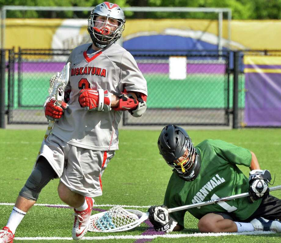 Niskayuna's #3 Lucas Maloney reacts to a goal  past Cornwall goalie Victor Ramos, at right, in the boys' lacrosse state tournament game in Albany, NY, Saturday June 1, 2013.  (John Carl D'Annibale / Times Union) Photo: John Carl D'Annibale / 00022652B