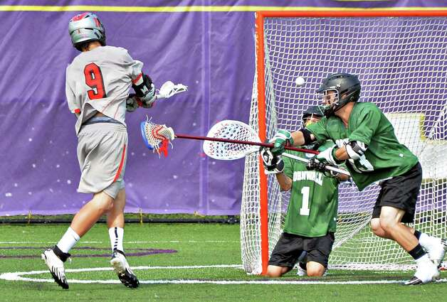 Niskayuna's #9 Luke Goldstock scores past Cornwall goalie Victor Ramos and defender John Roth, at right, in the boys' lacrosse state tournament game in Albany, NY, Saturday June 1, 2013.  (John Carl D'Annibale / Times Union) Photo: John Carl D'Annibale / 00022652B