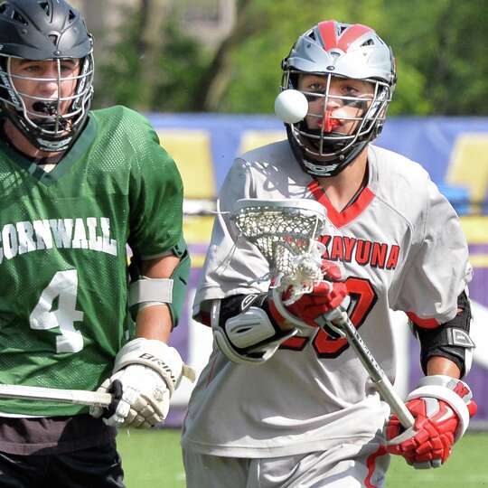 Niskayuna's #20 Tyler Pantalone, at right, during the boys' lacrosse state tournament game against C