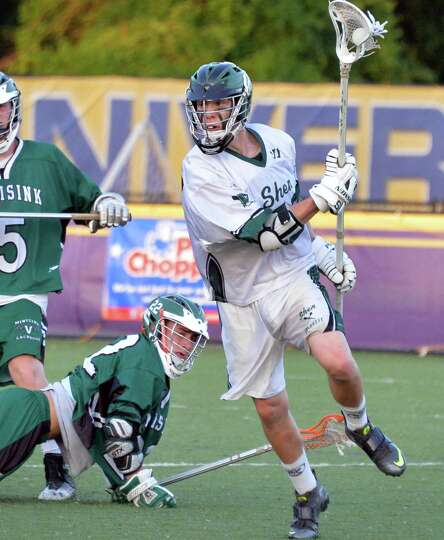 Shen's #20 Brian Guiry, at right, gets past Minnisink Valley's 22 Jimmy Pratti during their state to