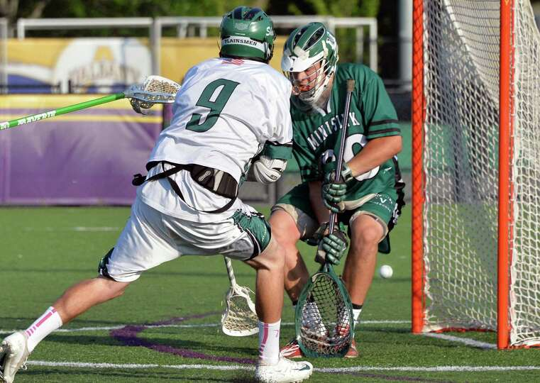 Shen's #9 Joe Romano scores against Minnisink Valley goalie #30 Matt Bogdanski, at right, during the