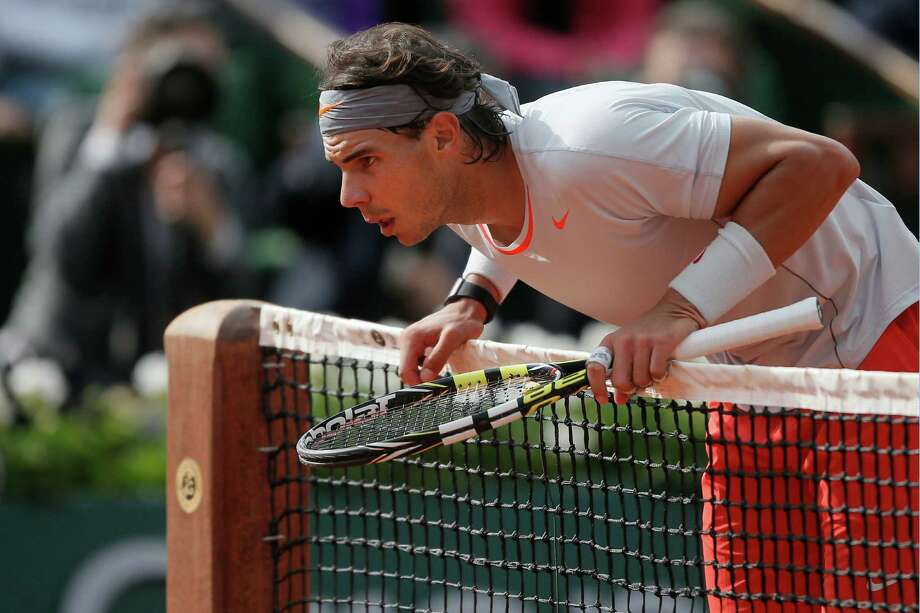 Spain's Rafael Nadal checks the mark of a ball on the court in his third round match against Italy's Fabio Fognini at the French Open tennis tournament, at Roland Garros stadium in Paris, Saturday, June 1, 2013. (AP Photo/Michel Spingler) Photo: Michel Spingler