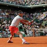 Defending champion Spain's Rafael Nadal returns the ball to Italy's Fabio Fognini during their third round match of the French Open tennis tournament at the Roland Garros stadium Saturday, June 1, 2013 in Paris. (AP Photo/Christophe Ena)