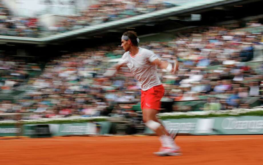 Defending champion Spain's Rafael Nadal returns the ball to Italy's Fabio Fognini during their third round match of the French Open tennis tournament at the Roland Garros stadium Saturday, June 1, 2013 in Paris. (AP Photo/Christophe Ena) Photo: Christophe Ena