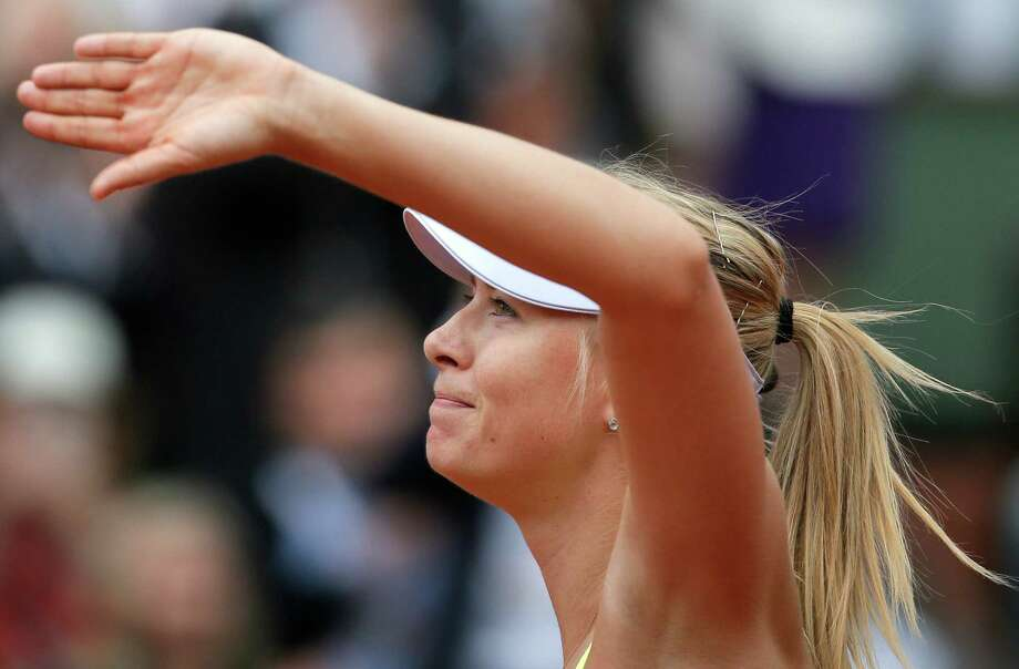 Russia's Maria Sharapova waves to the public after defeating China's Jie Zheng during their third round match of the French Open tennis tournament at the Roland Garros stadium Saturday, June 1, 2013 in Paris. (AP Photo/Michel Spingler) Photo: Michel Spingler
