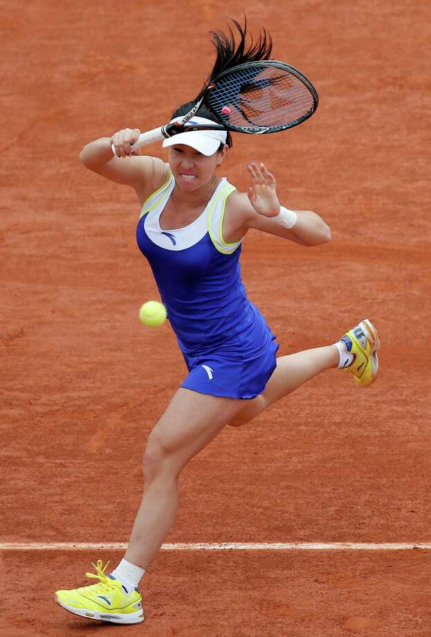 China's Zheng Jie returns the ball to Russia's Maria Sharapova during their third round match of the French Open tennis tournament at the Roland Garros stadium Saturday, June 1, 2013 in Paris. (AP Photo/Michel Spingler) Photo: Michel Spingler