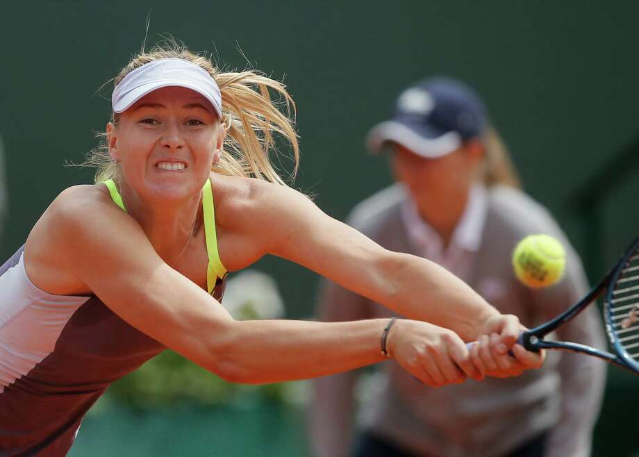Russia's Maria Sharapova returns the ball to China's Jie Zheng during their third round match of the French Open tennis tournament at the Roland Garros stadium Saturday, June 1, 2013 in Paris. Sharapova won 6-1, 7-5. (AP Photo/Michel Spingler) Photo: Michel Spingler