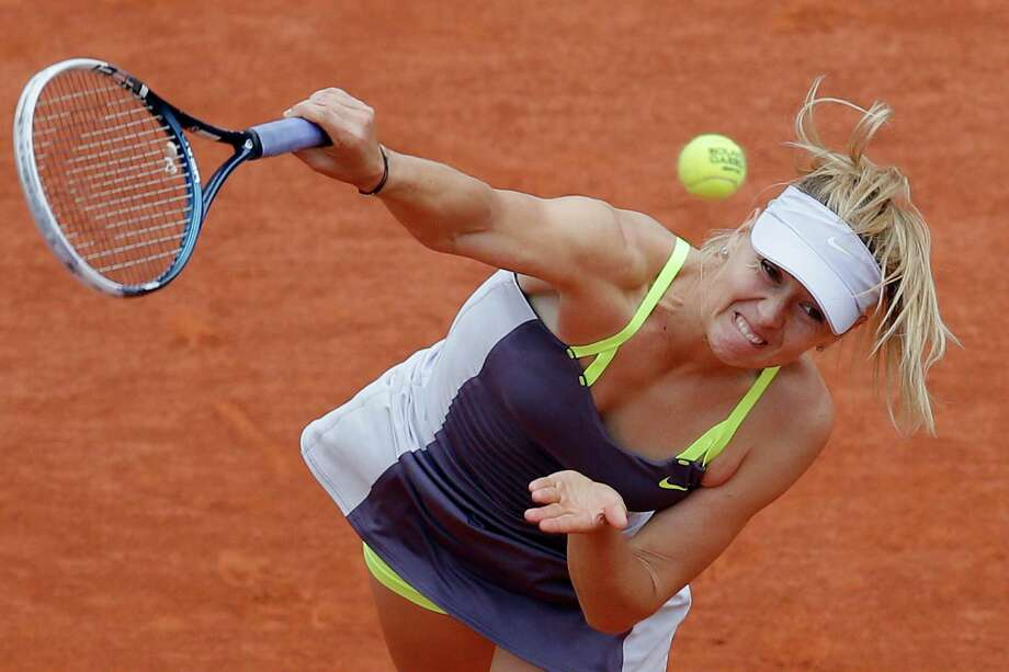 Russia's Maria Sharapova serves the ball to China's Zheng Jie during their third round match of the French Open tennis tournament at the Roland Garros stadium Saturday, June 1, 2013 in Paris. (AP Photo/Michel Spingler) Photo: Michel Spingler