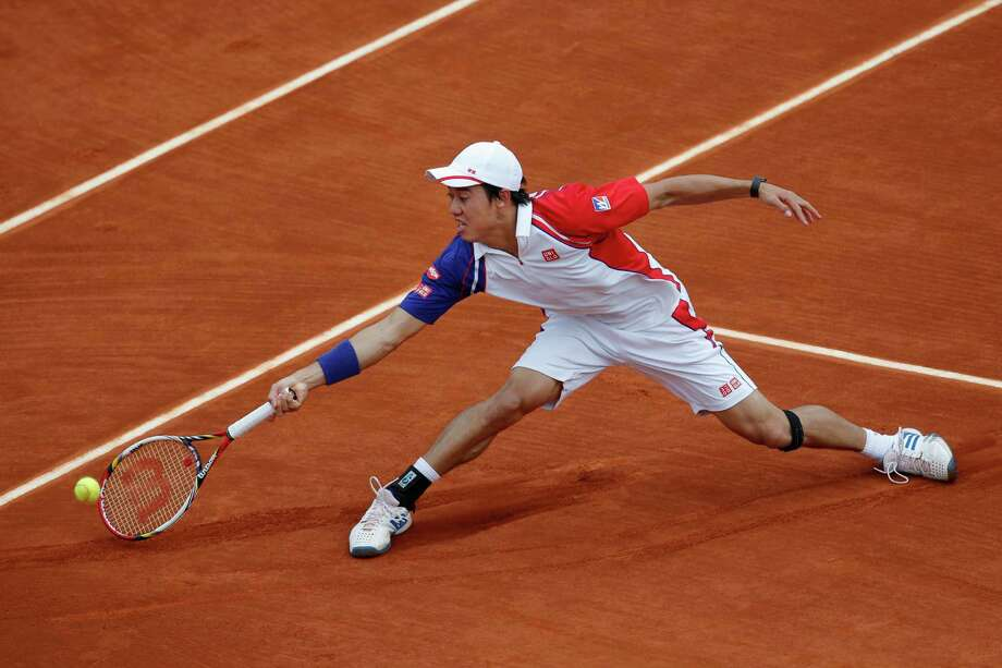 Japan's Kei Nishikori returns against  Benoit Paire of France in their third round match at the French Open tennis tournament, at Roland Garros stadium in Paris, Saturday, June 1, 2013. (AP Photo/Christophe Ena) Photo: Christophe Ena