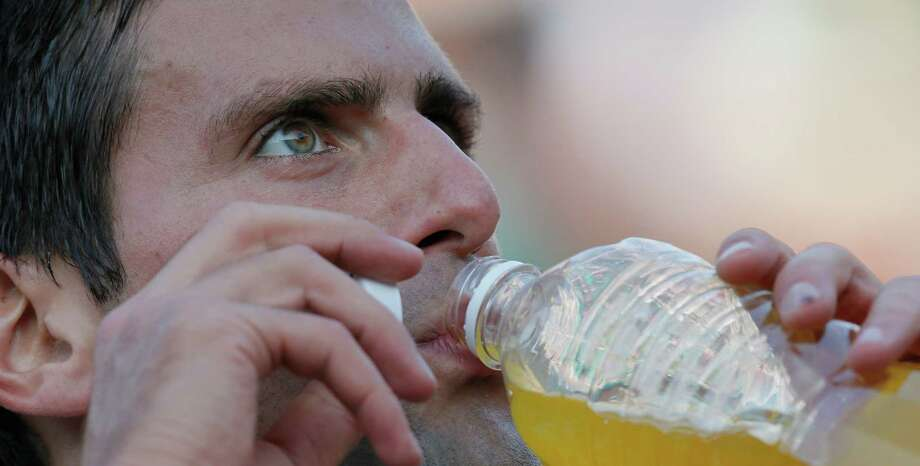 Serbia's Novak Djokovic drinks in his match against Bulgaria's Grigor Dimitrov in their third round match at the French Open tennis tournament, at Roland Garros stadium in Paris, Saturday, June 1, 2013. (AP Photo/Michel Spingler) Photo: Michel Spingler