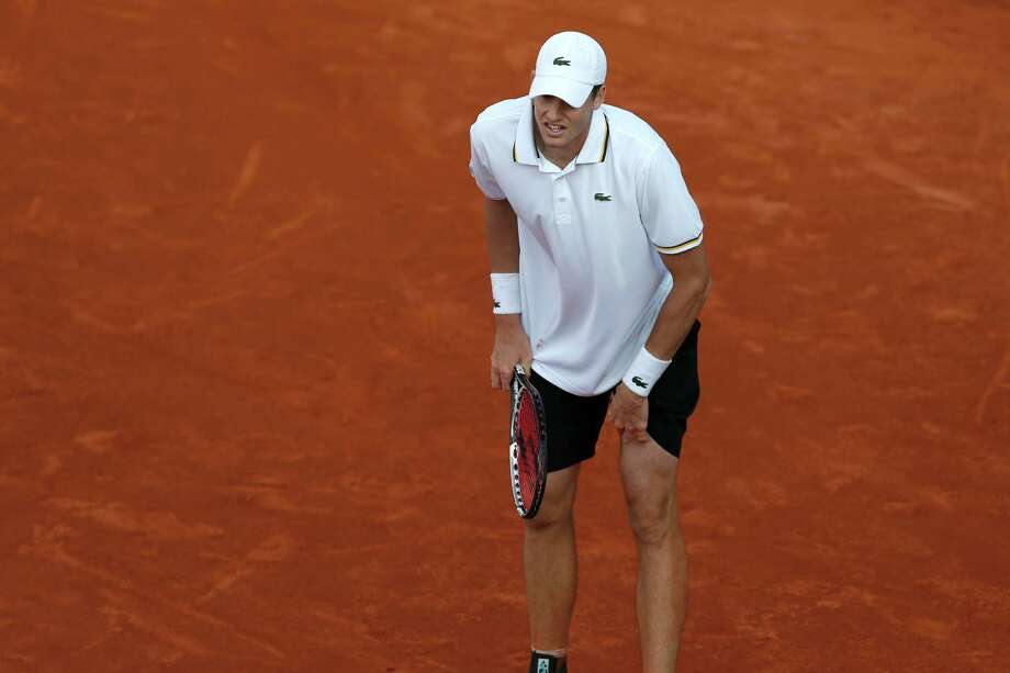 John Isner of the U.S. suffers from a cramp in his third round match agains Tommy Haas of Germany at the French Open tennis tournament, at Roland Garros stadium in Paris, Saturday, June 1, 2013. Isner lost in five sets. (AP Photo/Petr David Josek) Photo: Petr David Josek