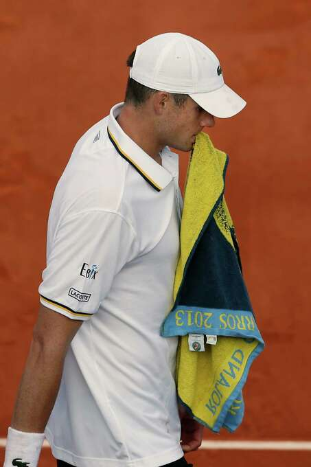John Isner of the U.S. holds his towel in his third round match agains Tommy Haas of Germany at the French Open tennis tournament, at Roland Garros stadium in Paris, Saturday, June 1, 2013. Isner lost in five sets. (AP Photo/Petr David Josek) Photo: Petr David Josek