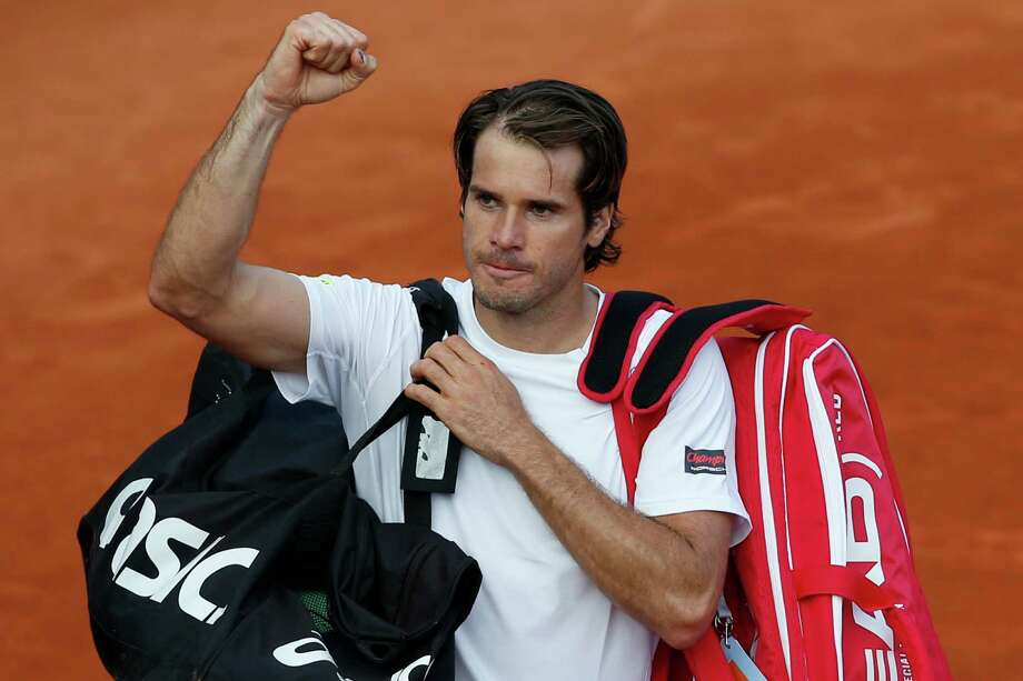 Tommy Haas of Germany clenches his fist after defeating John Isner of the U.S. in their third round match at the French Open tennis tournament, at Roland Garros stadium in Paris, Saturday, June 1, 2013. (AP Photo/Petr David Josek) Photo: Petr David Josek