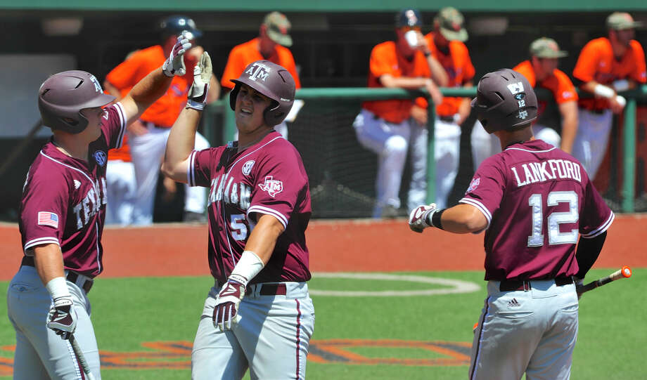 Texas A&M's Hunter Melton, right, earns a high-five after scoring one of the Aggies' three runs in the fifth inning of Saturday's 6-1 victory over UTSA. Photo: Greg Wahl-Stephens, FRE / FR29287 AP