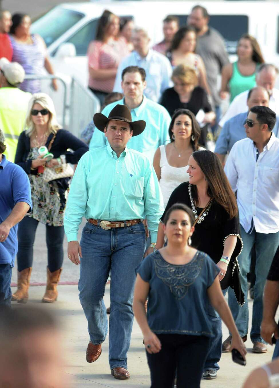 People arrive at the Alamodome for George Strait's
