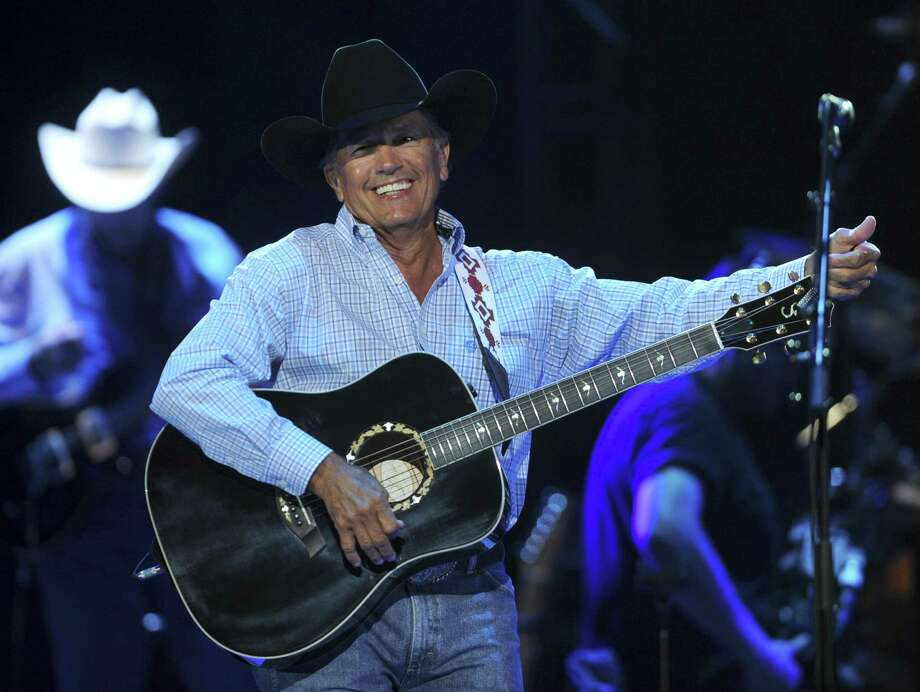 "George Strait, who was born in Poteet, performs his hit ""Ocean Front Property"" at the Alamodome. Photo: Photos By Billy Calzada / San Antonio Express-News"