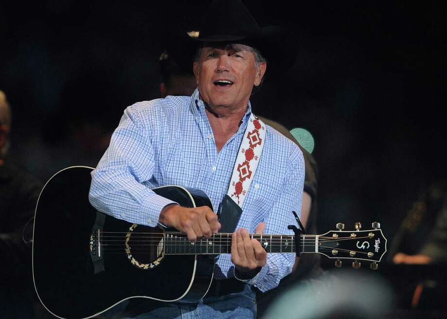 "George Strait performs during his ""The Cowboy Rides Away"" tour in the Alamodome on Saturday, June 1, 2013. Photo: San Antonio Express-News / San Antonio Express-News"