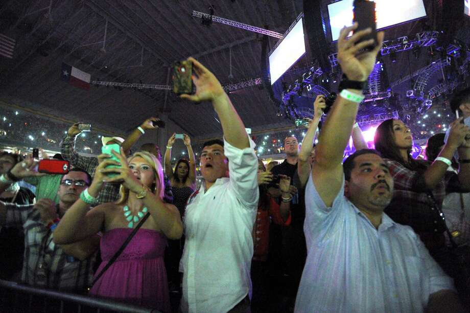 "Fans anticipate the arrival of George Strait during his ""The Cowboy Rides Away"" tour in the Alamodome on Saturday, June 1, 2013. Photo: San Antonio Express-News / San Antonio Express-News"