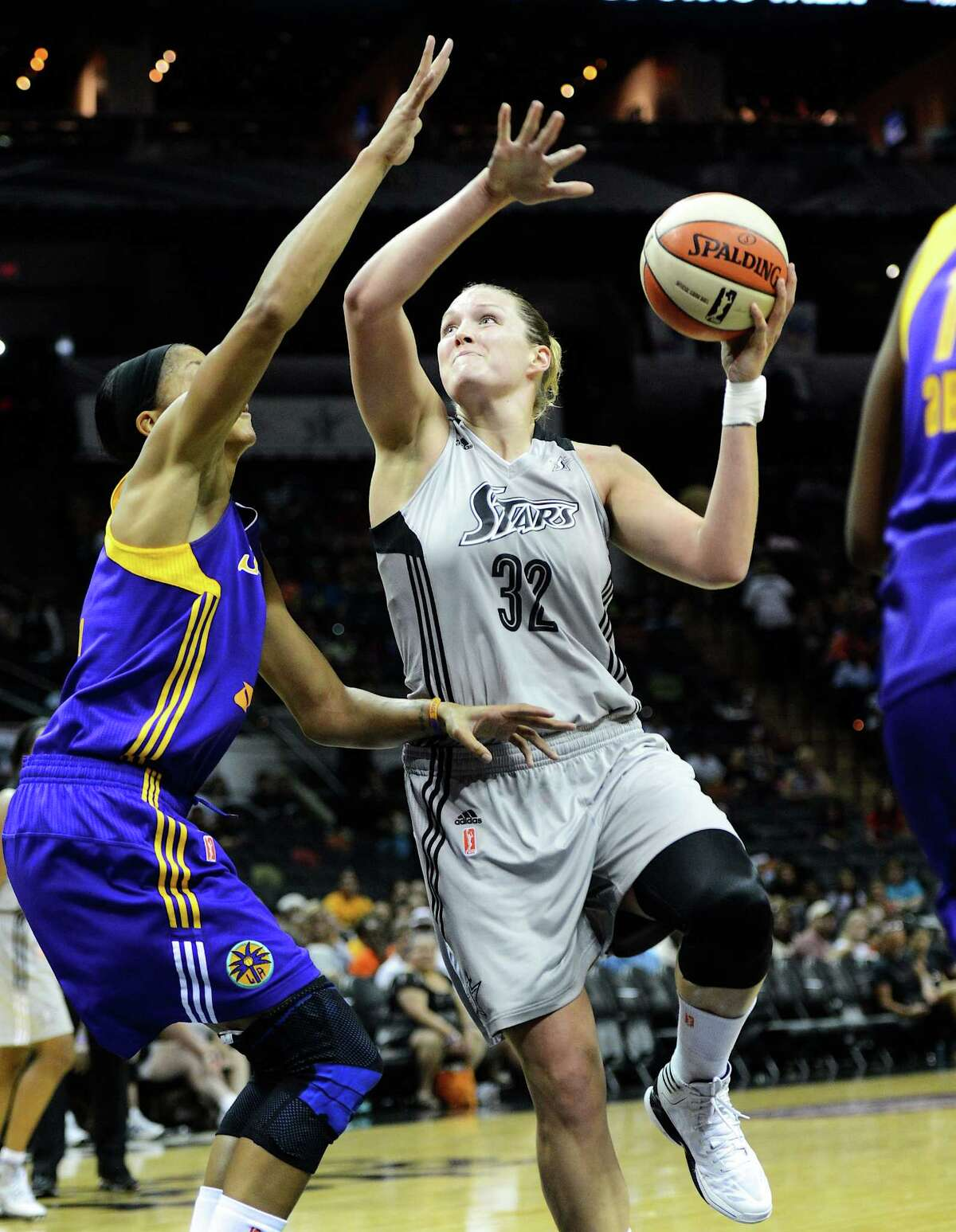 Silver Stars post Jayne Apple moves to take a shot over the Los Angeles Sparks' Candace Parker. Appel only had four points but collected a team-high nine rebounds.