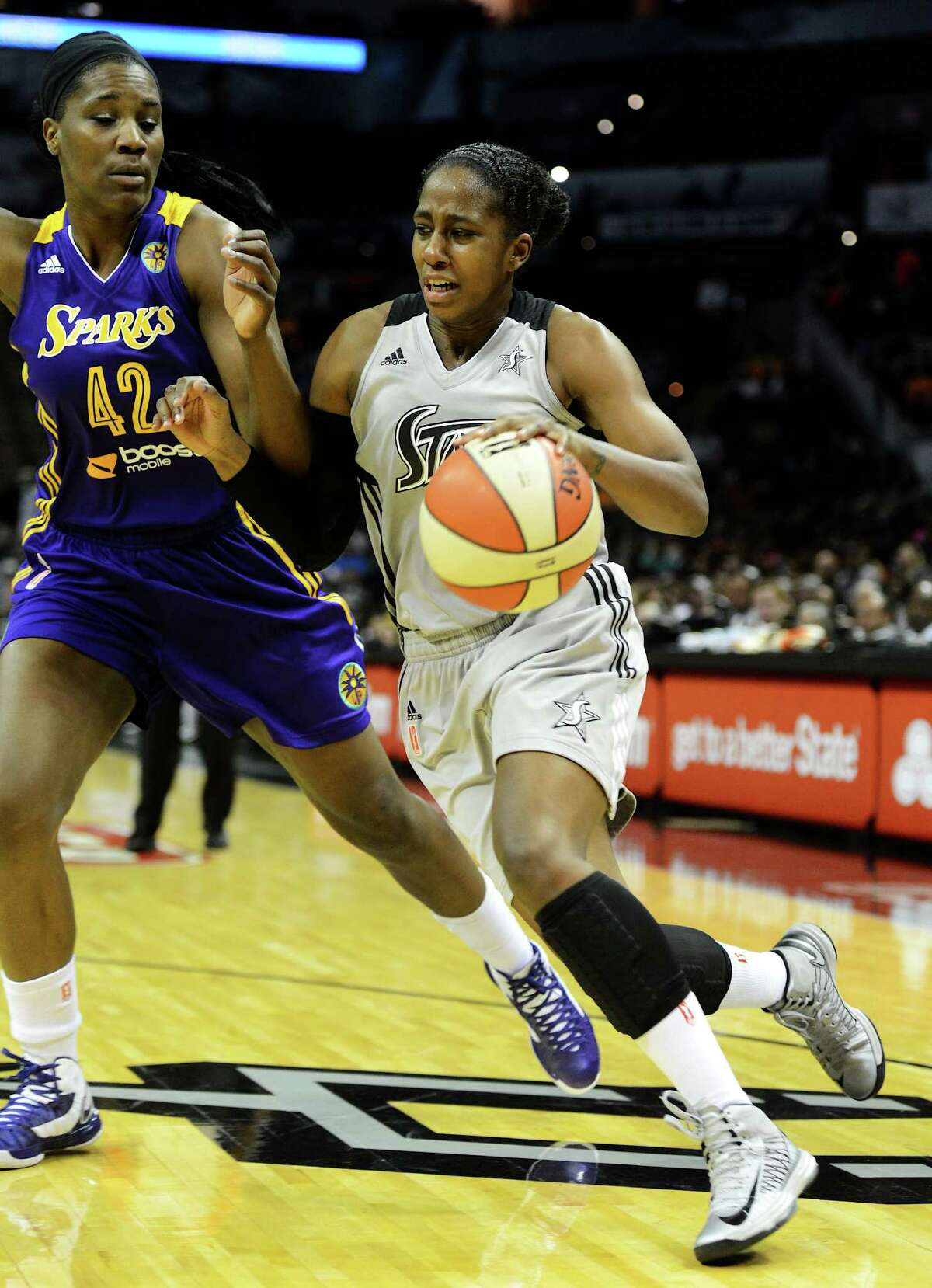 San Antonio Silver Stars' Shenise Johnson (42) drives to the basket around Los Angeles Sparks' Jantel Lavender (42) during a WNBA game at the AT&T Center. John Albright / Special to the Express-News