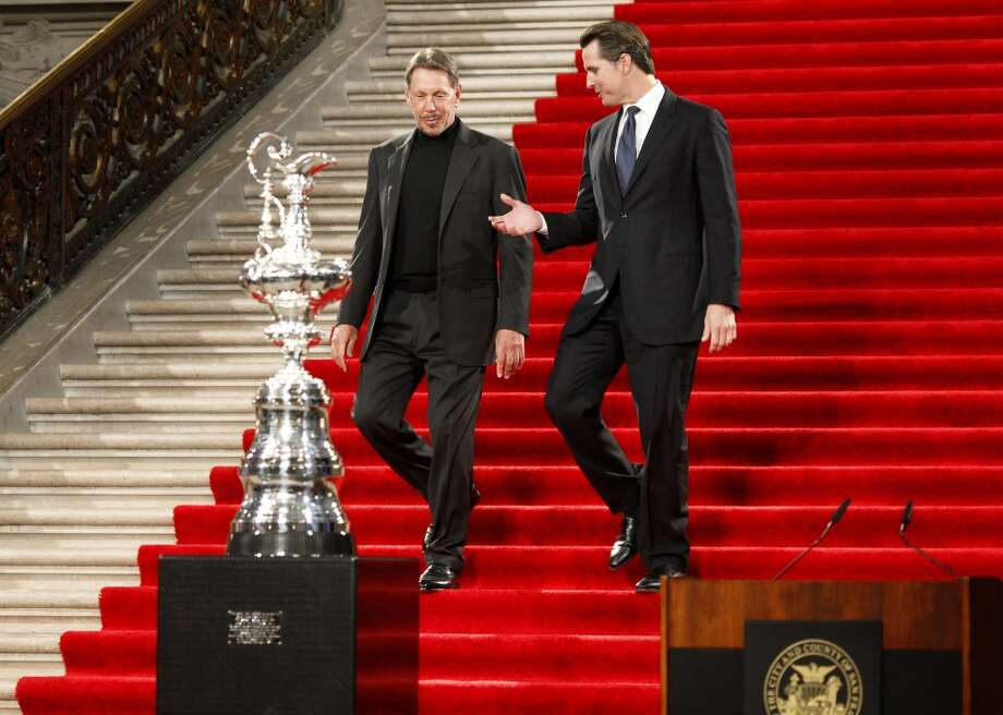 ORACLE racing owner Larry Ellison (left), and San Francisco Mayor Gavin Newsom walked down a red carpet to the podium on the rotunda and the America's Cup trophy.