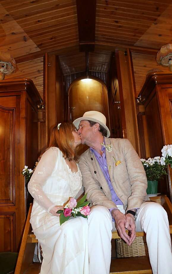 Newlyweds Joni Keim and Mark Treadwell aboard a boat on the Seine River in Paris. Photo: Courtesy Of Joni Keim