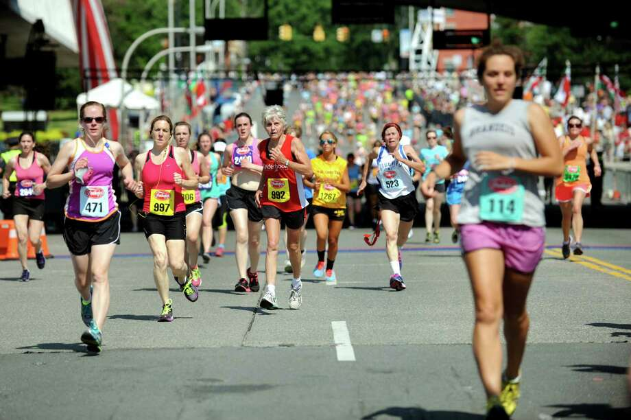 Runners approach the finish line during the 35th annual Freihofer's Run for Women on Saturday, June 1, 2013, in Albany, N.Y. (Cindy Schultz / Times Union) Photo: Cindy Schultz / 00022653A