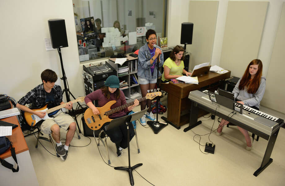 Students rehearse jazz selections for their upcoming spring concert at the Regional Center for the Arts in Trumbull, Conn. on Thursday May 16, 2013. The concert will be held May 29 and 30 at 7 p.m. A $5 donation is requested. Photo: Christian Abraham / Connecticut Post