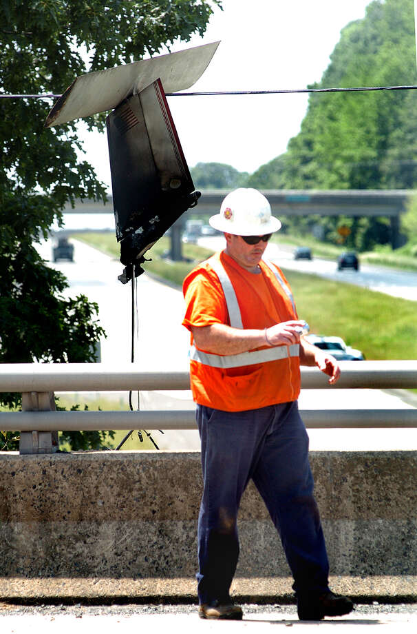 A PECO employee checks the wires holding the tail of the ultra-light plane that crashed on Route 611 near Route 313 Saturday, June 1, 2013 in Doylestown, Pa. Authorities say a pilot was flown to a hospital after a small plane hit power lines and crashed in suburban Philadelphia. Photo: AP