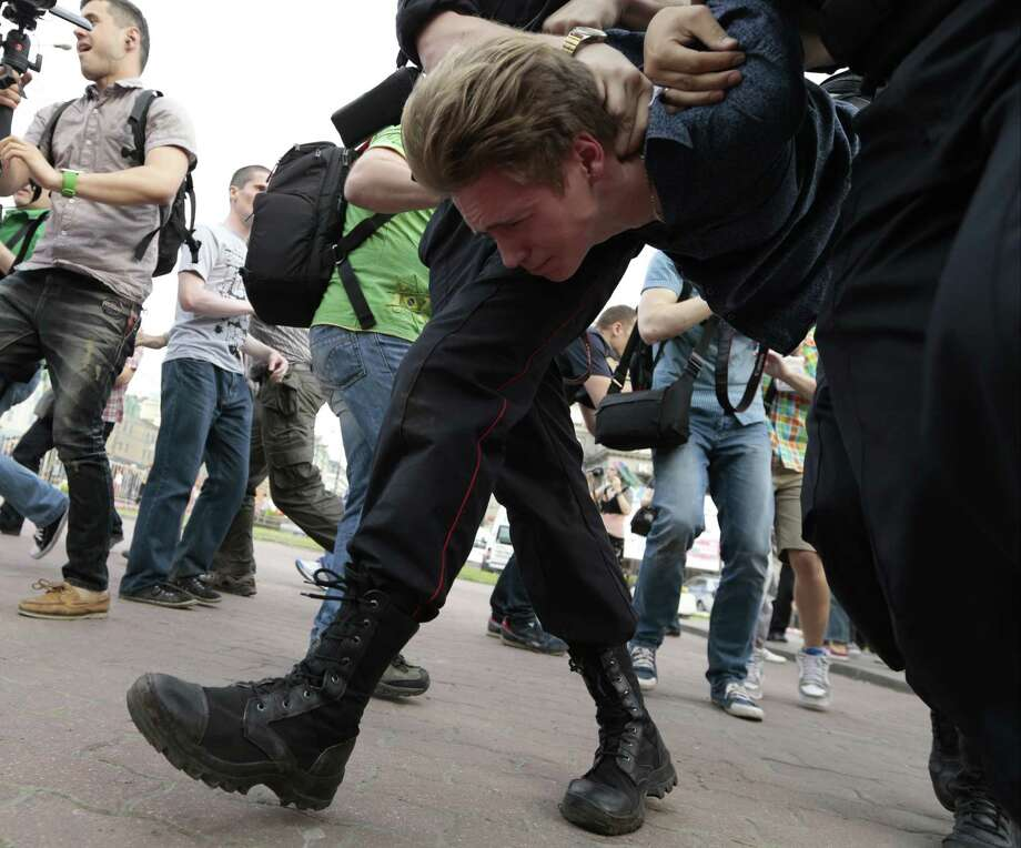 Police detain an opposition supporter during an unsanctioned opposition rally in downtown Moscow, Russia, Friday, May 31, 2013. The Russian opposition protests on the 31st of each month are a nod to the 31st article of the Russian constitution, which guarantees the right of assembly. Photo: AP