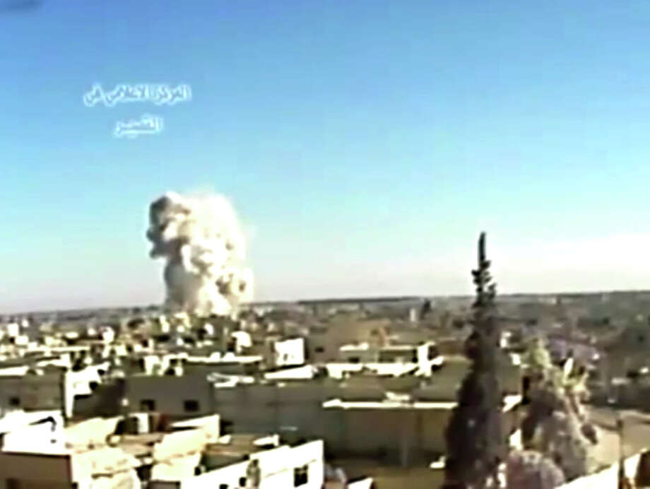 This image made from video posted by Ugarit News and taken on Wednesday, May 29, 2013, which is consistent with other AP reporting, shows an explosion from shelling in Qusair, Syria. Syrian President Bashar Assad said the regime has received its first shipment of a sophisticated Russian anti-aircraft missile system, and the main Western-backed opposition group announced Thursday that it will not participate in peace talks - a double blow to international efforts to end the country's devastating civil war. Photo: AP
