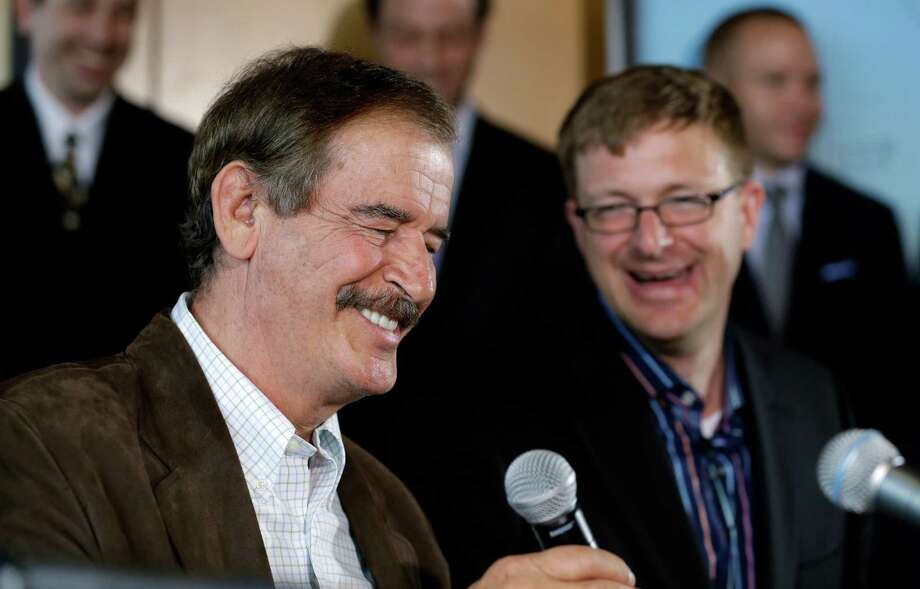Former Mexican President Vicente Fox, left, speaks as Jamen Shively, CEO of Diego Pellicer, looks on during a news conference Thursday, May 30, 2013, in Seattle. Diego Pellicer Inc. announced recent acquisitions of medical marijuana dispensary chains in Washington and Colorado, creating the first national brand of retail cannabis. Diego also spoke about plans to expand across the United States and internationally, and to become the market leader in both medical and adult-use marijuana. Photo: AP