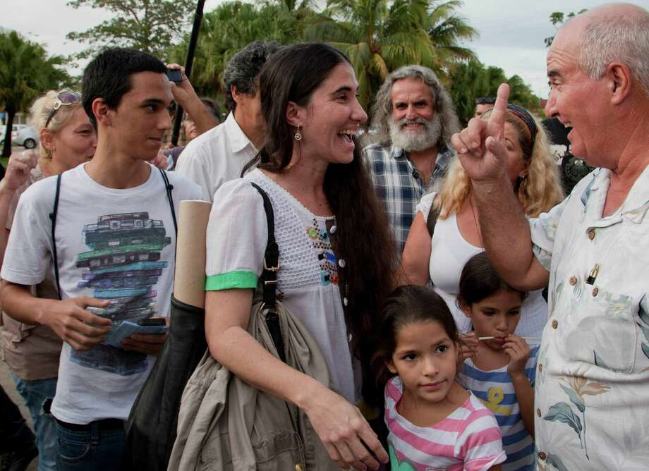 Cuban dissident blogger Yoani Sanchez is surrounded by relatives after her arrival, at the Jose Marti International Airport in Havana, Cuba, Thursday, May 30, 2013.  Sanchez is back home after a more than three-month globe-trotting tour that has turned her into the most internationally recognizable face in the island's small dissident community. Sanchez has been on the road since Feb. 17 and visited more than a dozen countries in Europe and the Americas. Photo: AP