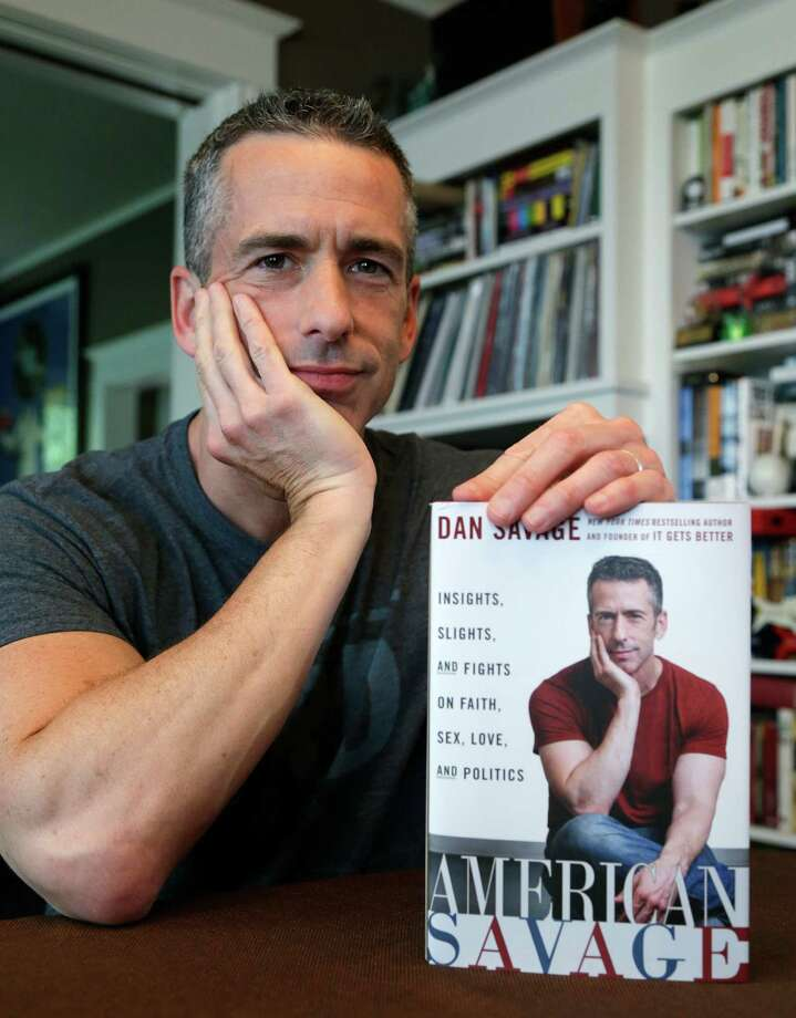 "In this photo taken on May 22, 2013, author Dan Savage is in his home in Seattle. Savage's latest book, ""American Savage,"" was released on Tuesday, May 28. Photo: AP"